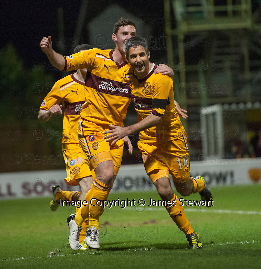 Motherwell's Keith Lasley (14) is congratulated by Robert McHugh after he scores Motherwell's third goal...