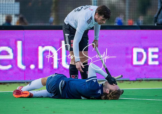AMSTELVEEN - sportblessure bij Pieter Sutorius (Pinoke) . met Wiegert Schut (Adam)   tijdens de competitie hoofdklasse hockeywedstrijd heren, Pinoke-Amsterdam (1-1)   COPYRIGHT KOEN SUYK