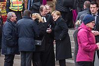 Gedenken am Dienstag den 19. Dezember 2017 anlaesslich des 1. Jahrestag des Terroranschlag auf den Weihnachtsmarkt auf dem Berliner Breitscheidplatz am 19.12.2016 durch den Terroristen Anis Amri.<br /> Im Bild: Teilnehmer des Gedenkgottesdienst in der Kaiser-Wilhelm Gedaechtniskirche haben sich im Anschluss an den Gottesdienst am Gedenkort vor der Kirche versammelt. Unter ihnen viele Angehoerige der 12 Ermordeten und Politiker.<br /> Bundeskanzlerin Angela Merkel (rechts) und der Pfarrer der Kaiser-Wilhelm Gedaechtniskirche, Martin Germer (2.vr.).<br /> 19.12.2017, Berlin<br /> Copyright: Christian-Ditsch.de<br /> [Inhaltsveraendernde Manipulation des Fotos nur nach ausdruecklicher Genehmigung des Fotografen. Vereinbarungen ueber Abtretung von Persoenlichkeitsrechten/Model Release der abgebildeten Person/Personen liegen nicht vor. NO MODEL RELEASE! Nur fuer Redaktionelle Zwecke. Don't publish without copyright Christian-Ditsch.de, Veroeffentlichung nur mit Fotografennennung, sowie gegen Honorar, MwSt. und Beleg. Konto: I N G - D i B a, IBAN DE58500105175400192269, BIC INGDDEFFXXX, Kontakt: post@christian-ditsch.de<br /> Bei der Bearbeitung der Dateiinformationen darf die Urheberkennzeichnung in den EXIF- und  IPTC-Daten nicht entfernt werden, diese sind in digitalen Medien nach §95c UrhG rechtlich geschuetzt. Der Urhebervermerk wird gemaess §13 UrhG verlangt.]