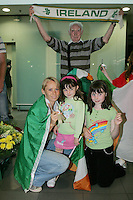 2/8/2010. Derval O'Rourke arrives back into Dublin Aiorport pictrured with fans Grainne 5 and Sarah 9 Hanley from Skryne Co Meath with Henry Gorman from Dublin. European silver-medallist Derval O'Rourke has arrived home from Barcelona.O'Rourke finished second in the 100m hurdles on Saturday night to win her second European Athletics Championship silver medal. She was presented with her medal at the Olympic Stadium in Barcelona yesterday evening. Picture James Horan/Collins Photos.
