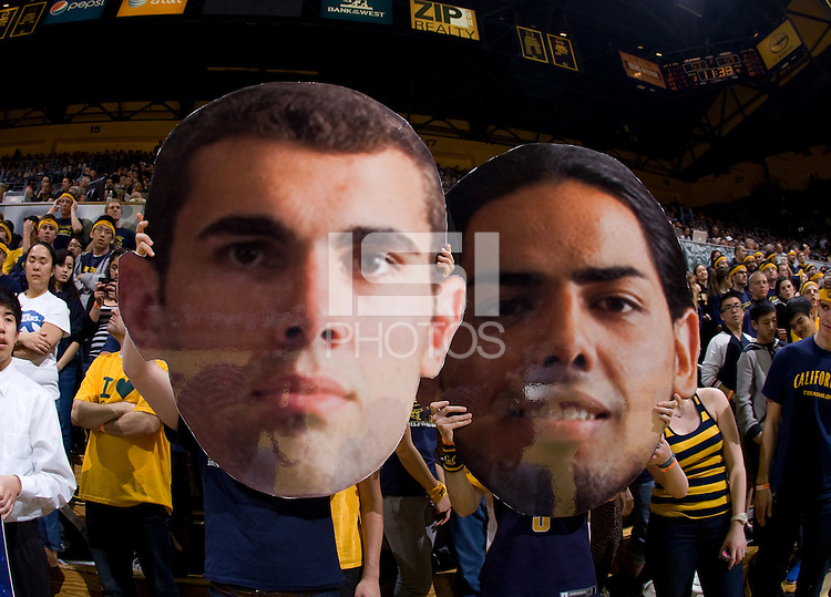 California fans hold up huge faces of Harper Kamp and Jorge Gutierrez during the game between California and Oregon at Haas Pavilion in Berkeley, California on February 16th, 2012.  California defeated Oregon, 86-83.