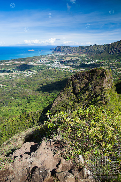 A view from the top of Olomana's highest peak of Waimanalo and the Ko'olau Mountain Range on a crystal clear day, Windward O'ahu; Rabbit, Bird and even Moloka'i Islands can be seen in the distance.