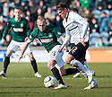 Raith Rovers' Ross Callachan tries to get away from Hib's Dylan McGeouch.