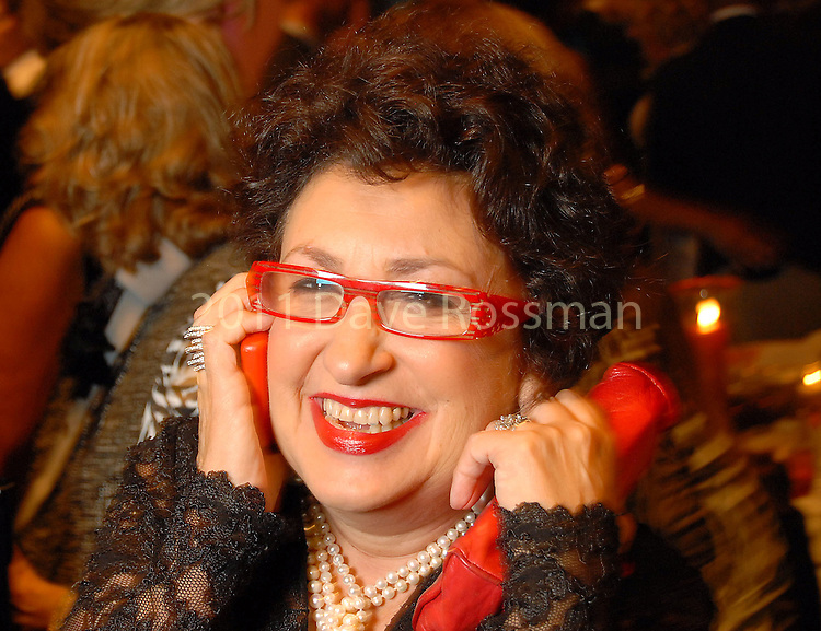 Roz Pactor answers a call at the Night of Stars Gala honoring Houston's top fashion designers at the Junior League of Houston Tuesday Nov. 03,2009. (Dave Rossman/For the Chronicle)
