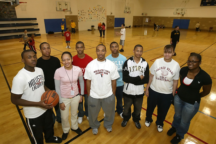 WATERBURY, CT, 01/05/08- 010508BZ02- From left- Ta-Quon Zimmerman, 16, Marcus Johnson, 17, Antonia Stallings, 17, B.J. Kline, 15, Youth Teen Leader Mike Stallings, Donald Cardoza, 17, Jonathan Rosado, 16, Devin Davis, 17, and S'Ri Johnson, 16 volunteer with the YMCA Youth Basketball League Saturday afternoon. The program brings in local athletes who volunteer to coach and mentor the kids.<br /> Jamison C. Bazinet Republican-American