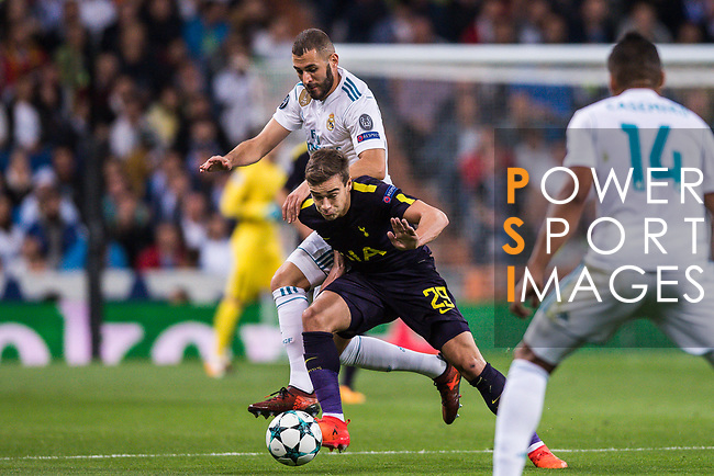 Harry Winks of Tottenham Hotspur FC (front) fights for the ball with Karim Benzema of Real Madrid (back) during the UEFA Champions League 2017-18 match between Real Madrid and Tottenham Hotspur FC at Estadio Santiago Bernabeu on 17 October 2017 in Madrid, Spain. Photo by Diego Gonzalez / Power Sport Images
