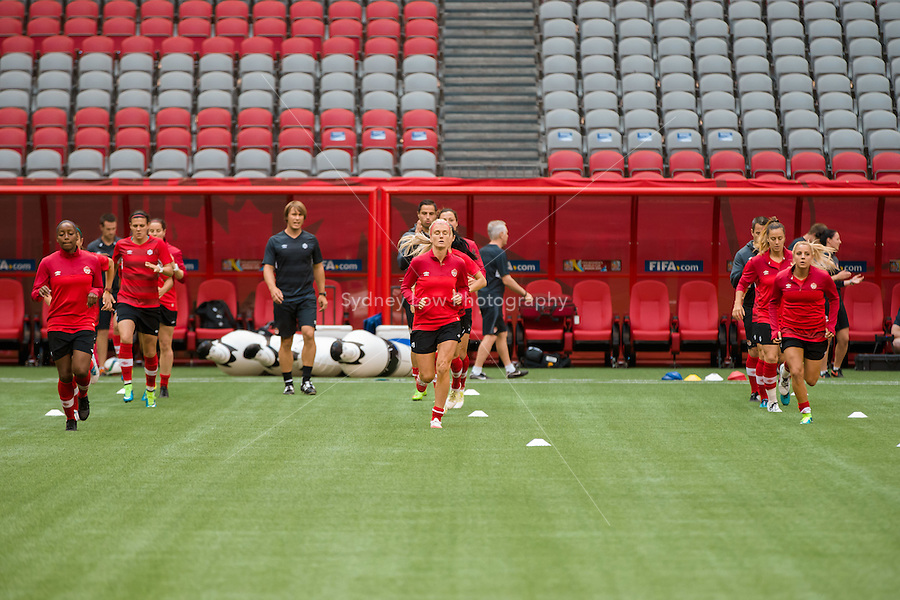 June 20, 2015: The Canadian team at an official practise session prior to a round of 16 match between Canada and Switzerland at the FIFA Women's World Cup Canada 2015 at BC Place Stadium on 21 June 2015 in Vancouver, Canada. Sydney Low/Asteriskimages.com