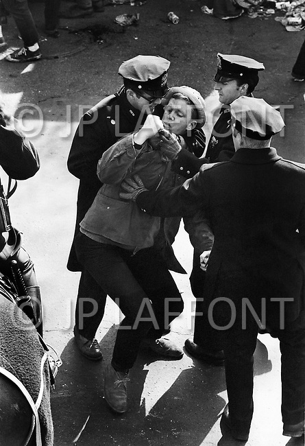 Manhattan, New York City, NY. March 17th, 1970.<br /> A man getting held up by the police during St. Patrick's Day Parade on 5th Ave. at 96th.