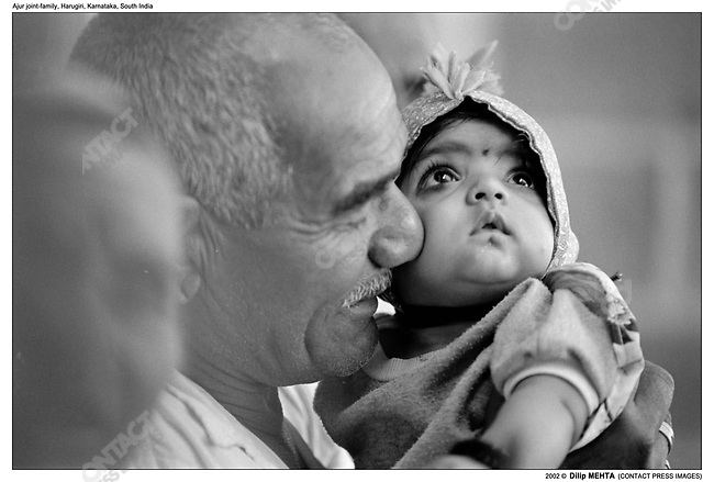 .A portrait of the Patriarch (Brother no. 3) caressing  Sachin - the youngest member of  the family...