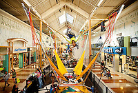 Wide-angle photography inside Concord Mills Mall, a 1.4 million-square-foot mall located in Concord, NC, about 12 miles from Charlotte, NC. In this image, Destinee Alford, 10, gets some air as she flips on The Mall Jump. Photo is part of a photographic series of images featuring Concord, NC, by photographer Patrick Schneider.