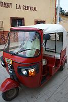 Three wheeled motorized taxi in Santa Elena, Yucatan, Mexico.