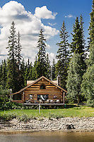 Log cabin home on the banks of the Chena River, Fairbanks, Alaska, USA