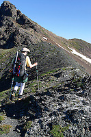Man hiking on mountain ridge, Tomyhoi Peak, Yellow Aster Butte region, Whatcom County, North Cascades, Washingto