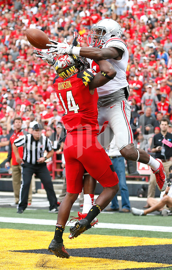 Maryland Terrapins defensive back Jeremiah Johnson (14) was called for interference as Ohio State Buckeyes wide receiver Michael Thomas (3) almost comes down with a TD reception late in the 3rd quarter at Byrd Stadium on October 4, 2014.  (Chris Russell/Dispatch Photo)