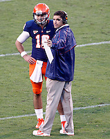 Virginia Cavaliers quarterback Michael Rocco (16) talks with offensive coordinator Bill Lazor during the game against Maryland in Charlottesville, Va. Maryland defeated Virginia 27-20.