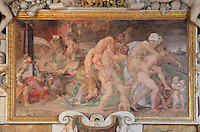 The Twins of Catania, with people fleeing a burning city, fresco by Rosso Fiorentino, 1535-37, in a carved stucco frame, in the Galerie Francois I, begun 1528, the first great gallery in France and the origination of the Renaissance style in France, Chateau de Fontainebleau, France. The Palace of Fontainebleau is one of the largest French royal palaces and was begun in the early 16th century for Francois I. It was listed as a UNESCO World Heritage Site in 1981. Picture by Manuel Cohen