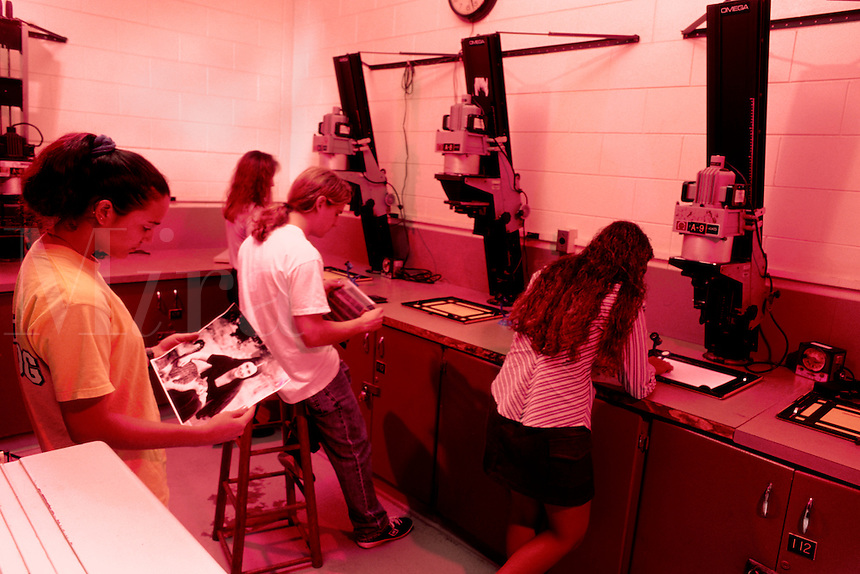 College students in photography class working at the darkroo