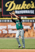 Augusta shortstop Emmanuel Burris (5) catches a fly ball versus Kannapolis at Fieldcrest Cannon Stadium in Kannapolis, NC, Monday, September 3, 2007.