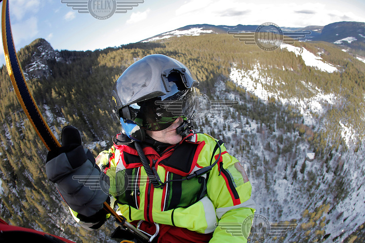 Crew from Norwegian Air Ambulance practice rescue skills at Camp Torpomoen, a training facility...Einar Brendryen, rescue paramedic during pick up training.