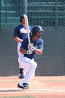 Reymond Fuentes #27 of the San Diego Padres bats during a Minor League Spring Training Game against the Kansas City Royals at the Kansas City Royals Spring Training Complex on March 26, 2014 in Surprise, Arizona. (Larry Goren/Four Seam Images)