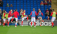 Wales players warm up ahead of the FIFA World Cup Qualifying match between Wales and Serbia at the Cardiff City Stadium, Cardiff, Wales on 12 November 2016. Photo by Mark  Hawkins.