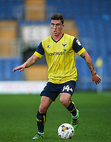 Josh Ruffels of Oxford United on the ball during the The Checkatrade Trophy match between Oxford United and Exeter City at the Kassam Stadium, Oxford, England on 30 August 2016. Photo by Andy Rowland / PRiME Media Images.