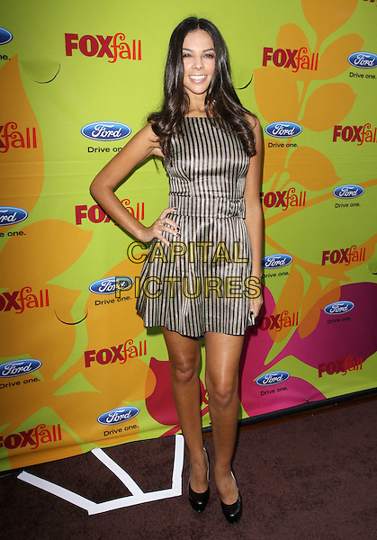 TERRI SEYMOUR.FOX Fall 2009 Eco-Casino Party held at BOA Steakhouse, West Hollywood, California, USA..September 14th, 2009.full length teri brown black striped stripes dress hand on hip sleeveless beige .CAP/ADM/KB.©Kevan Brooks/AdMedia/Capital Pictures.