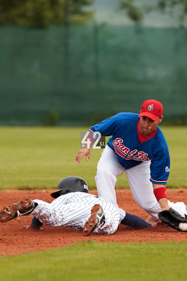 03 June 2010: Daniel Sanchez of C.B. Sant Boi fails to tag out Kenji Hagiwara of Rouen during the 2010 Baseball European Cup match won  8-4 by C.B. Sant Boi over the Rouen Huskies, at the Kravi Hora ballpark, in Brno, Czech Republic.