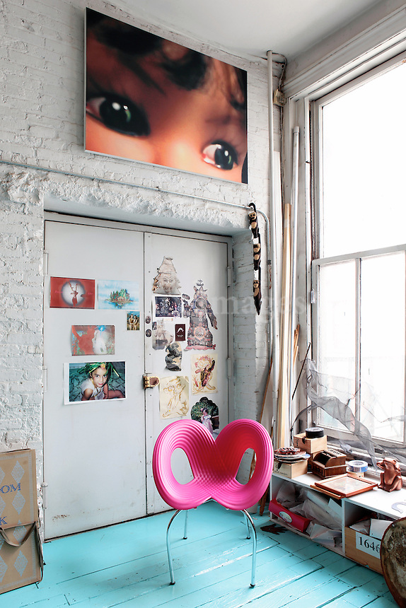 modern fuschia chair..Lydia Venieri lives with her husband and her two daughters in Soho, New York. Her 250 square meter loft is mainly furnished with Chinese antiques bought from New York City's Chinatown.