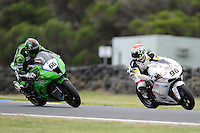 PHILLIP ISLAND, 22 FEBRUARY - Jakub Smrz (CZE) riding the Ducati 1098R (96) of the Team Effenbert - Liberty Racing glances over at Tom Sykes (GBR) riding the Kawasaki ZX-10R (66) of the Kawasaki Superbike Racing Team on day two of the testing session prior to round one of the 2011 FIM Superbike World Championship at Phillip Island, Australia. (Photo Sydney Low / syd-low.com)