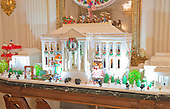 """The 2016 White House Christmas decorations are previewed for the press at the White House in Washington, DC on Tuesday, November 29, 2016.  Pictured is the White House Gingerbread House that is made with 150 pounds of gingerbread on the inside, 100 pounds of bread dough on the outside frame, 20 pounds of gum paste, 20 pounds of icing, and 20 pounds of sculpted sugar pieces. The first lady's office released the following statement to describe those decorations, """"This year's holiday theme, 'The Gift of the Holidays,' reflects on not only the joy of giving and receiving, but also the true gifts of life, such as service, friends and family, education, and good health, as we celebrate the holiday season.""""<br /> Credit: Ron Sachs / CNP"""