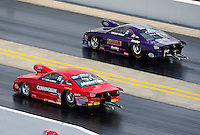 Sept. 17, 2010; Concord, NC, USA; NHRA pro stock driver Bob Glidden (near) races alongside Vincent Nobile  during qualifying for the O'Reilly Auto Parts NHRA Nationals at zMax Dragway. Mandatory Credit: Mark J. Rebilas/