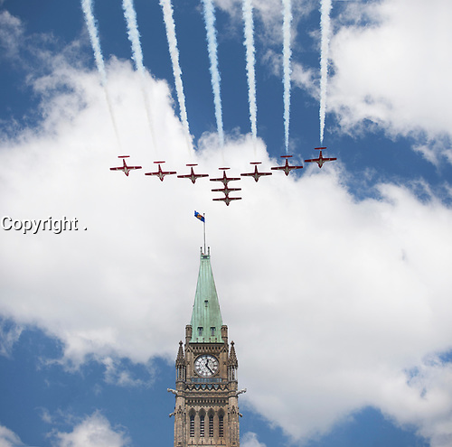 July 1st 2011 File Photo - Ottawa, Ontario, CANADA - Hand Out photo - Snowbirds fly over Peace Tower on Canada Day 2011.<br /> <br /> Les Snowbirds survolant la tour de la Paix lors de la fête du Canada 2011.<br /> <br /> <br /> <br /> <br /> Photo credit: National Capital Commission<br /> Crédit photo: Commission de la capitale nationale