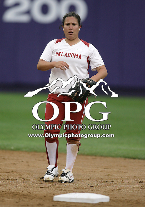 28 May 2010:  Oklahoma Sooners second baseman #4 Amber Flores warms up between innings against Washington.  Washington defeated Oklahoma 3-0 in the second game of the NCAA Super Regional at Husky Softball Stadium in Seattle, WA.