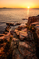 Sunrise over the rocky shoreline of Acadia National Park, Maine.