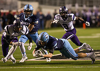 Arkansas Democrat-Gazette/MELISSA SUE GERRITS - 12/05/15 -  Har-Ber's Luke Hannon recovers his own fumble late in the second quarter during their 7A Championship game against Fayetteville December 5, 2015 at War Memorial Stadium in Little Rock.