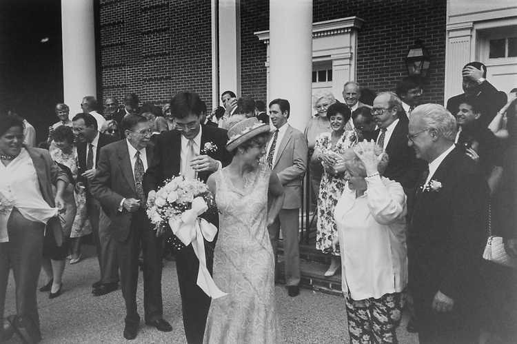 Rep. Bill Paxon, R-N.Y. and Rep. Susan Molinari, R-N.Y. at budseed throwing outside the church on their wedding day. July 3, 1994. (Photo by Tim Burger/CQ Roll Call)