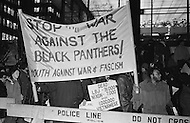 "09 Dec 1969, Manhattan, New York City, New York State, USA. American protesters of Youth Against War and Fascism holding a banner with stating ""Stop the War Against the Black Panthers!"" in front of the Waldorf Astoria Hotel where President Richard Nixon is attending a National Football Foundation Dinner."