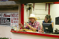 "Auctioneer and owner of the Enumclaw Sales Pavilion, Ron Mariotti, talks to the crowd during the livestock auction on May 9, 2015. Mariotti disagrees with claims that there were no other bidders in the room during Ray's auction. ""Why did they keep bidding if there were no other bidders?' he responds."