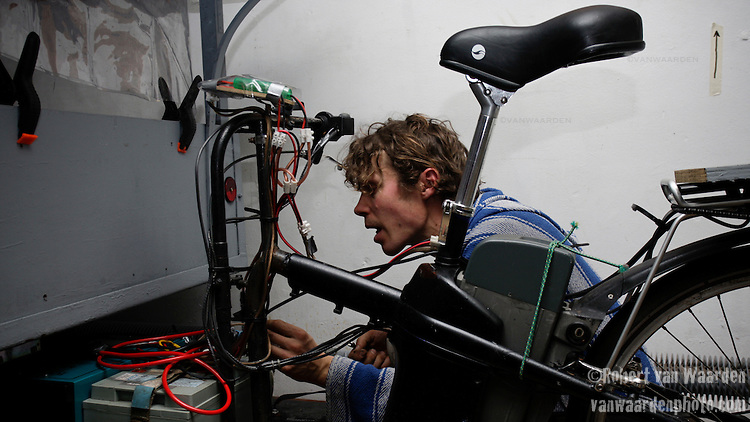 Eric de Groen works on the bike generating system.