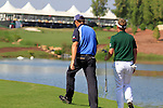 Padraig Harrington and Luke Donald walk to the 18th tee box during Day 2 of the Dubai World Championship, Earth Course, Jumeirah Golf Estates, Dubai, 26th November 2010..(Picture Eoin Clarke/www.golffile.ie)