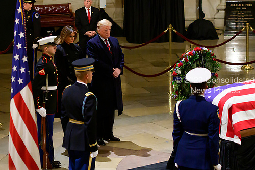 United States President Donald J. Trump and First lady Melania Trump pay their respects to former United States President George H.W. Bush, who is lying in state in the Rotunda of the US Capitol on Monday, December 3, 2018.<br /> Credit: Ron Sachs / CNP<br /> (RESTRICTION: NO New York or New Jersey Newspapers or newspapers within a 75 mile radius of New York City)