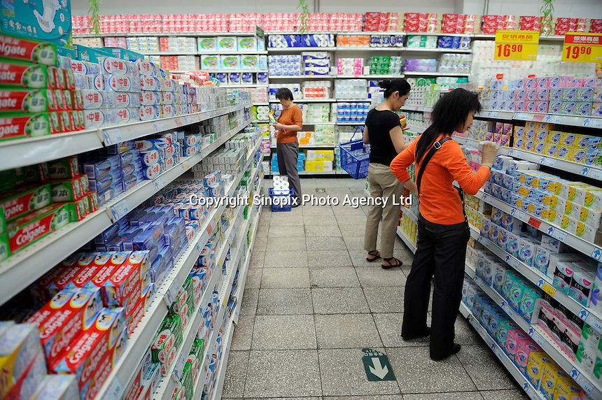 Chinese customers buying articles for washing at a Wu Mart supermarket in Beijing, China.  Wu Mart, the Beijing-based chain, was founded in the early 1990s by Zhang Wenzhong. Its name smacks of the fame of U.S. retail giant Wal-Mart. Wu Mart and Wal-Mart are competing in different arenas and each appears to be going after a different class of consumer. By 2005, Wu Mart had more than 450 hypermarkets, supermarkets and convenience stores, and is one of only a few Chinese retailers whose shares are publicly traded..28 May 2011