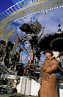 Artist Doc Evermor (also known as Tom Every) stands beneath his giant scrap metal sculpture, the Forevertron, in his Sauk Prairie, Wisconsin sculpture park.<br />  <br /> © Michael Forster Rothbart<br /> www.mfrphoto.com <br /> 607-267-4893 o 607-432-5984<br /> 5 Draper St, Oneonta, NY 13820<br /> 86 Three Mile Pond Rd, Vassalboro, ME 04989<br /> info@mfrphoto.com<br /> Photo by: Michael Forster Rothbart<br /> Date: 10/01     File#:   color slide.