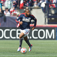 New England Revolution defender Andrew Farrell (2) brings the ball forward.  In a Major League Soccer (MLS) match, the New England Revolution (blue/white) tied Vancouver Whitecaps FC (white), 0-0, at Gillette Stadium on March 22, 2014.