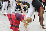 Maia Cunningham tries some capoeira at the Samba Festival on West Street...(Photo credit should read Jenny Matthews www.newsfile.ie)....This Picture has been sent you under the conditions enclosed by:.Newsfile Ltd..The Studio,.Millmount Abbey,.Drogheda,.Co Meath..Ireland..Tel: +353(0)41-9871240.Fax: +353(0)41-9871260.GSM: +353(0)86-2500958.email: pictures@newsfile.ie.www.newsfile.ie.