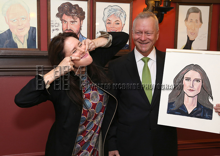Julie Taymor and Max Klimavicius attends the Julie Taymor Sardi's Caricature unveiling at Sardi's Restaurant on November 3, 2017 in New York City.