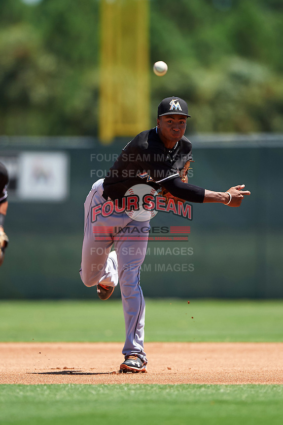 GCL Marlins third baseman James Nelson (5) throws to first during the second game of a doubleheader against the GCL Cardinals on August 13, 2016 at Roger Dean Complex in Jupiter, Florida.  GCL Cardinals defeated GCL Marlins 2-0.  (Mike Janes/Four Seam Images)