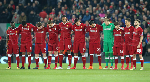6th March 2018, Anfield, Liverpool, England; UEFA Champions League football, round of 16, 2nd leg, Liverpool versus FC Porto; Liverpool players line up to observe the minute's silence in memory of Fiorentina player Davide Astori who passed away earlier this week