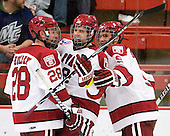 Chris Huxley (Harvard - 28), Alex Killorn (Harvard - 19) and Danny Biega (Harvard - 9) celebrate Killorn's goal. - The visiting Merrimack College Warriors defeated the Harvard University Crimson 3-1 (EN) at Bright Hockey Center on Tuesday, November 30, 2010.